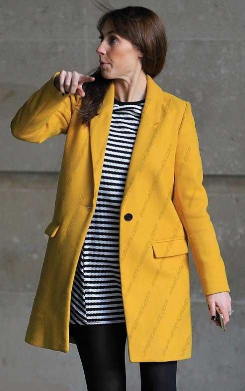 Alex-Jones-TV-Host-Yellow-Coat